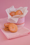 Cookies in round box with pink napkin and pink background Royalty Free Stock Photography