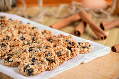 Cookies in rows on white kitchen towel. Cinnamon, rope, box in the background. horizontal Royalty Free Stock Photography