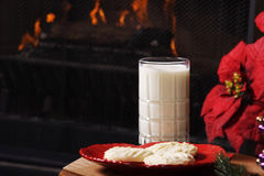 Cookies For Santa. Christmas Eve scene.  Shortbread cookies and milk set out by the fireplace, in preparation for Santa's arrival Royalty Free Stock Photos