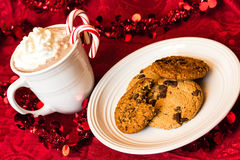 Cookies for Santa. Chocolate chip cookies with mug of hot chocolate for Santa in festive setting Royalty Free Stock Image