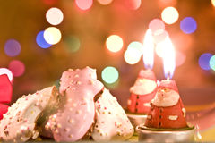 Cookies and Santa candle for Christmas. Christmas cookies and Santa Claus candles and lights Royalty Free Stock Photos