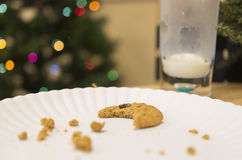 Cookies for Santa Claus. Eaten cookies and milk out for Santa at Christmas time Royalty Free Stock Photo