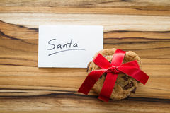 Cookies for santa. Close up of a tack of cookies with a red ribbon and a note for Santa Stock Photo