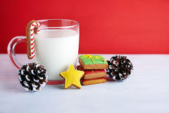 Cookies for Santa: ginger cookies, milk and christmas decoration Stock Photo