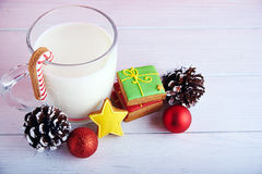 Cookies for Santa: ginger cookies, milk and christmas decoration Stock Images