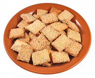 Cookies with sesame seeds on a ceramic plate on a white Stock Photo