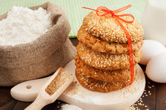 Cookies with sesame seeds, flour and eggs royalty free stock photos