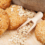 Cookies with sesame seeds on wooden board royalty free stock photo