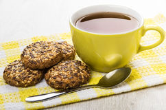 Cookies with sesame and sunflower seeds and tea on napkin Royalty Free Stock Photo