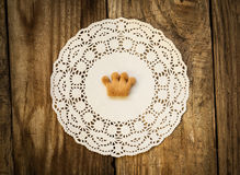 Cookies in the shape of a crown. On a white napkin on a wooden table Royalty Free Stock Image