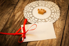 Cookies in the shape of a crown. On a white napkin on a wooden table and isolated card Stock Photos