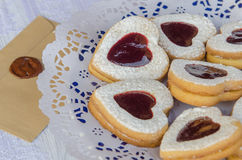 Cookies in the shape of heart with raspberry jam stock image