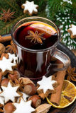 Cookies in the shape of stars, spices and a cup of mulled wine Royalty Free Stock Photo