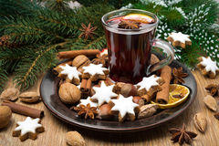 Cookies in the shape of stars, spices and mulled wine on a plate stock photography