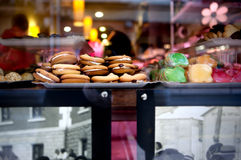 Cookies showcase. Showcase pastry shop with a variety of pastries and muffins. Stock Photos