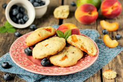 Cookies with slices of fresh apricot on old wooden table Stock Photo