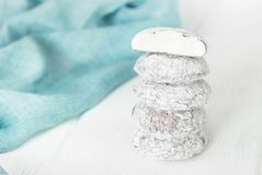 Cookies Snowball on white wooden background. Cookies Snowball on a white wooden background Royalty Free Stock Photo
