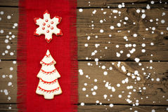 Cookies on Snowy Wooden Background Stock Photography
