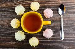 Cookies with souffle around cup of tea and teaspoon Royalty Free Stock Photography