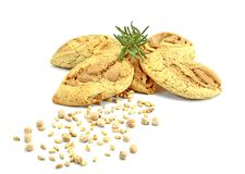 Cookies of soybeans and grains of wheal with twig of rosemary on white background