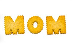 Cookies spelling mom. Designer, alphabet cookies arranged to spell words Royalty Free Stock Images