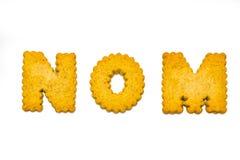 Cookies spelling nom. Designer, alphabet cookies arranged to spell words Stock Image