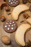 Cookies, spices and nuts on a wooden background Stock Image