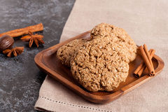 Cookies and spices on a wooden plate, close-up Royalty Free Stock Images