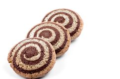 Cookies with a spiral pattern on a white background royalty free stock image