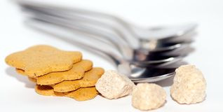 Cookies, spoons and sugar Royalty Free Stock Photos