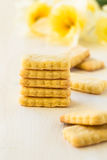 Cookies and spring flowers on white background Stock Images