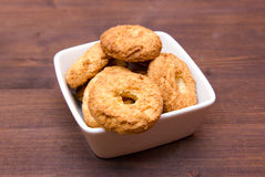 Cookies on square bowl on wood Royalty Free Stock Photos