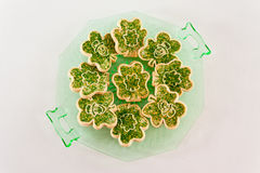 Cookies for St. Patrick's Day. A plate of cookies decorated with shamrocks and leprechauns Royalty Free Stock Images