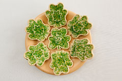 Cookies for St. Patrick's Day. A plate of cookies decorated with shamrocks and leprechauns Stock Images