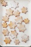 Cookies stars on white baking paper Stock Photos