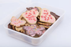 Cookies in a storage box. Studio-shot of a food storage box full with cookies Royalty Free Stock Photo