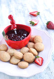 Cookies and strawberry jam Stock Images