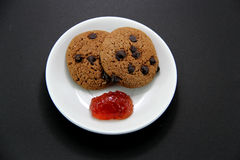 Cookies and strawberry jam Stock Photo