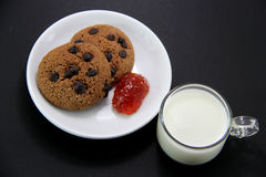 Cookies and strawberry jam Royalty Free Stock Images