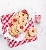 Cookies with sugar drops in a metal bowl with raspberries ready to decorate for holiday or gift Royalty Free Stock Photos
