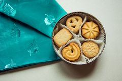 Cookies with sugar in a round box. And a green napkin royalty free stock photography