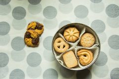 Cookies with sugar in a round box on a tablecloth with polka dots. Cookies with sugar in a round box and two lying on a tablecloth with polka dots stock image