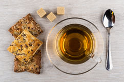 Cookies with sunflower seeds and sesame, sugar, teaspoon and tea Stock Image