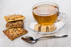 Cookies with sunflower seeds and sesame, sugar, teaspoon and tea Stock Photography