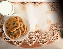 Three chocolate chip cookies on a table stock photo