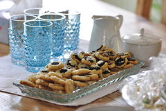 Cookies on table. A vase with cookies and tableware on a table in a wedding Royalty Free Stock Image