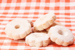 Cookies on a tablecloth red and white checkered background Stock Image