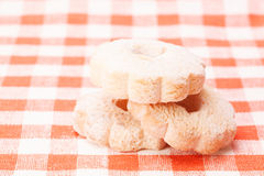 Cookies on a tablecloth red and white checkered background Royalty Free Stock Image