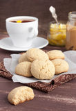 Cookies with tea. On the brown table royalty free stock image