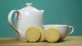 Cookies and tea. Delicious cookies with a cup of hot tea stock video footage